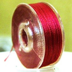 Extra strong, waxed stringing thread