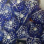 Plastic bead, blue heart